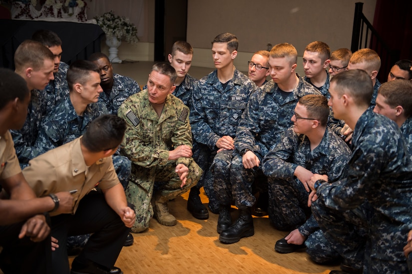 The Master Chief Petty Officer of the Navy, Mike Stevens discusses the importance of mental and physical fitness to Sailors during an all hands event at the Joint Base Charleston – Weapons Station, S.C., March 24, 2016. Stevens was visiting the base as part of a two-week tour of East Coast military bases, from Norfolk, Virgina to Key West Fla. Stevens wanted to communicate face-to-face with Sailors. (U.S. Air Force photo/Staff Sgt. Jared Trimarchi)