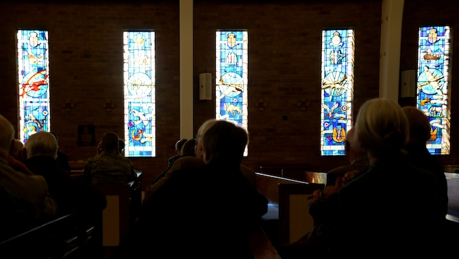 Clergy members from the local community view stained glass windows March 22, 2016, at the base chapel on RAF Mildenhall, England. Guests were greeted at the chapel to start off the Clergy Day tour. The event was organized to show appreciation to local clergy for supporting military members and their families during their tour in England. (U.S. Air Force photo by Senior Airman Justine Rho/Released)
