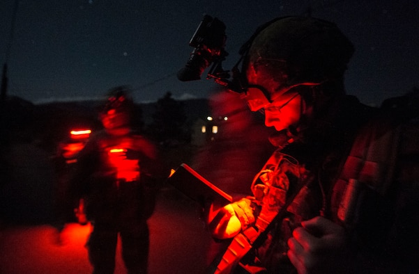 Sgt. Lane Starling, 1st Regiment, Royal Canadian Horse Artillery joint terminal attack controller, scans his area and speaks to a pilot as part of a night operations training scenario during exercise Serpentex '16 March 15, 2016, in Corsica, France. Training at night prepares JTACs to provide terminal control of both air and surfaced based fires at the tactical level in a more challenging setting.  Approximately 215 Airmen, including JTACs from the 2nd Air Support Operations Squadron, from Vilseck, Germany, participated in the annual exercise held at NATO's tactical training center and the French air force's Air Base 126 Solenzara, France. (U.S. Air Force/Staff Sgt. Sara Keller)