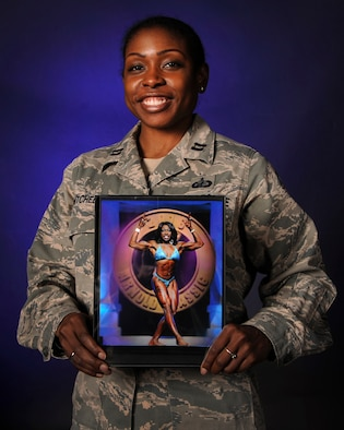 U.S. Air Force Capt. Tarah Mitchell, the 19th Comptroller Squadron financial analysis flight commander, proudly displays a photo of herself onstage at the 2016 Arnold Classic Women's Physique competition. Mitchell placed eighth in the prestigious event. (U.S. Air Force photo/Senior Airman Harry Brexel)