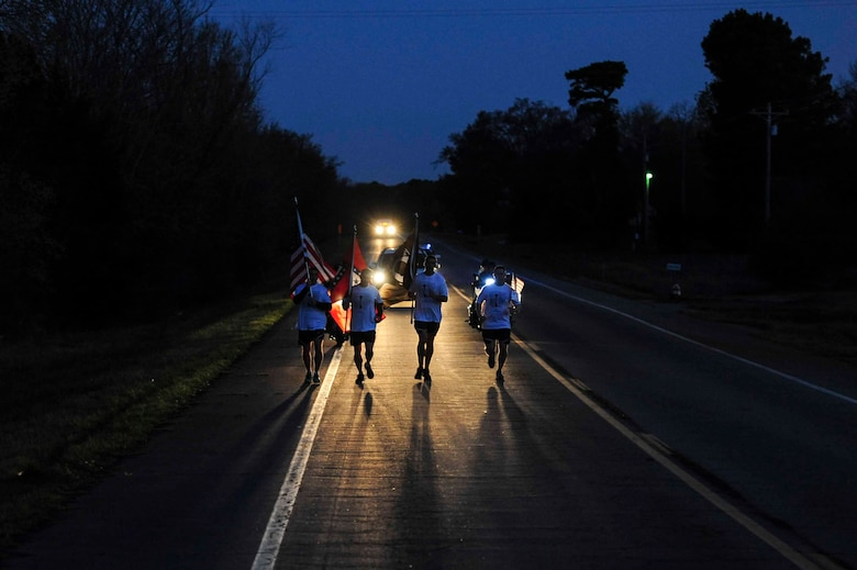 A team of Little Rock Air Force Base, Ark. first sergeants start Day Two of the Arkansas Run for the Fallen event March 19, 2016, in Clarksville, Ark. The 5th Annual Arkansas Run for the Fallen event is a cross-state run of 143 miles where each mile marks a fallen hero and has been identified with an American flag and a biography of each. (U.S. Air Force photo by Senior Airman Kaylee Clark)