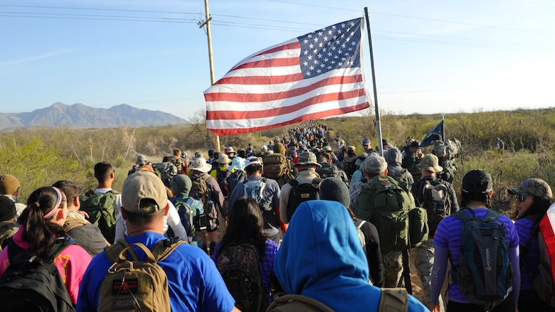 Military members, civilians, volunteers and veterans begin a 26.2-mile journey during the 2016 Bataan Memorial Death March, March 20, 2016, at White Sands Missile Range, N.M. The annual event draws more participants each year and provides today's generation with a reminder of  harsh conditions that World War II veterans were forced to endure during their 60-mile march to a prisoner of war camp in the Philippines (U.S. Air Force photo/Senior Airman Harry Brexel)