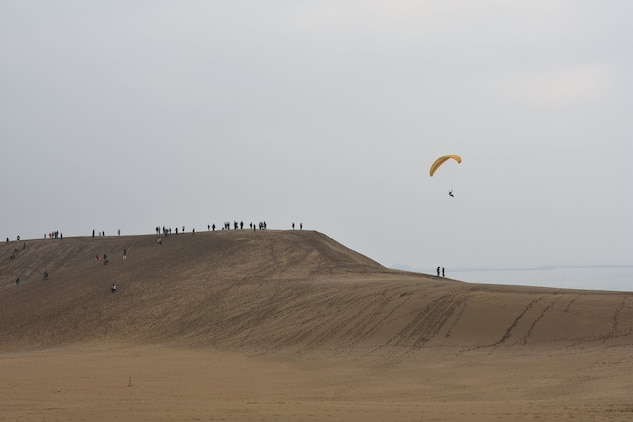 Marines from Marine Corps Air Station Iwakuni traveled to the Tottori Sand Dunes in Tottori Sakyu, Japan, March 19, 2016. After arriving in Tottori, the Marines ventured into the town, observed the scenery, visited temples, rode camels, sand boarded and parasailed. Created by sediment deposits carried from the Chugoku Mountains by the Sendai River into the Sea of Japan over the course of thousands of years, the Tottori Sand Dunes are the largest in Japan and are part of the Sanin Kaigan National Park. (Photo courtesy of Oana Ivanoff)