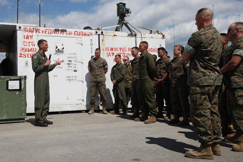Lt. Col. Kris Faught speaks to Marines with Marine Unmanned Aerial Vehicle Squadron 2 before the first RQ-21A Blackjack flight into Class D airspace over Marine Corps Air Station Cherry Point, N.C., March 21, 2016. The RQ-21A Blackjack system is modular, flexible and multi-mission capable, providing roll-on, roll-off transitions between land and maritime environments. Faught is the commanding officer of VMU-2. (U.S. Marine Corps photo by Pfc. Nicholas P. Baird/Released)