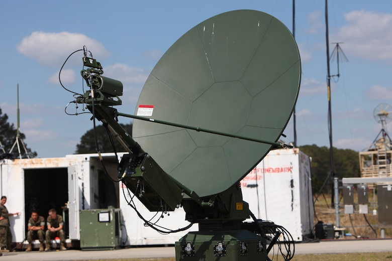 A very-small-aperture terminal medium communications system is positioned to assist Marines with Marine Unmanned Aerial Vehicle Squadron 2 in the communications with air traffic control during the first RQ-21A Blackjack flight into Class D airspace over Marine Corps Air Station Cherry Point, N.C., March 21, 2016. The RQ-21A Blackjack system is modular, flexible and multi-mission capable, providing roll-on, roll-off transitions between land and maritime environments. (U.S. Marine Corps photo by Pfc. Nicholas P. Baird/Released)