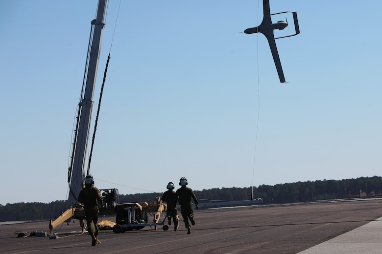 Marines with Marine Unmanned Aerial Vehicle Squadron 2 retrieve a RQ-21A Blackjack after recovery at Marine Corps Air Station Cherry Point, N.C., March 21, 2016. The RQ-21A Blackjack system is modular, flexible and multi-mission capable, providing roll-on, roll-off transitions between land and maritime environments. The aircraft was launched for the first time into Class D airspace over MCAS Cherry Point. (U.S. Marine Corps photo by Pfc. Nicholas P. Baird/Released)