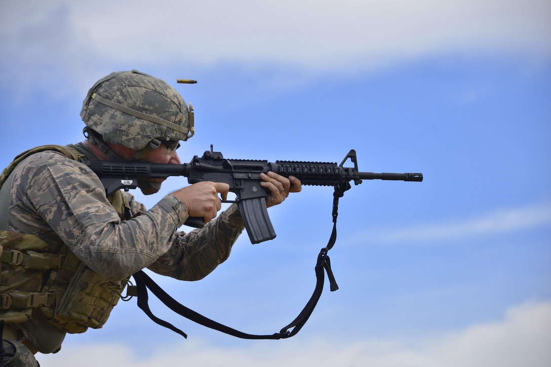 Tech. Sgt. Kyle Luthman, a security forces member, shoots an M4 carbine during the 3rd Annual Andrew Sullens State Marksmanship Competition at Fort Stewart, Ga., March 11, 2016. The competition, named after Georgia Army National Guardsman Andrew Sullens, is a premiere marksmanship event hosted by the Georgia National Guard Marksmanship Team. The competition goes beyond the traditional weapons qualification by integrating additional weapons systems and incorporating a simulated battlefield shooting scenario. (Air National Guard photo/Tech. Sgt. Amber Williams)