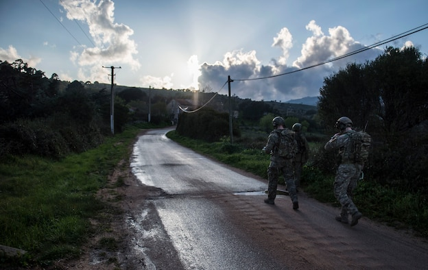 Tech. Sgt. Jeremy Rarang, Senior Airman Tormod Lillekroken and Staff Sgt. Seth Hunt, all 2nd Air Support Operations Squadron joint terminal attack controllers, walk along a road as part of a training scenario during exercise Serpentex 16 in Corsica, France, March 15, 2016. JTACs are considered qualified service members who direct the action of air and surfaced-based fires at the tactical level.  They are the Airmen on the ground with the authority to control and call in airstrikes on target. (U.S. Air Force photo/Staff Sgt. Sara Keller)