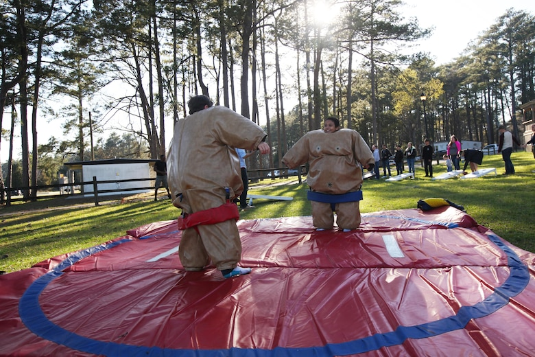 Cole, left, and Noah Sumo wrestle during the simiannual pig pickin' at Marine Corps Air Station Cherry Point, N.C., March 22, 2016. More than 300 Marines, family members and members of the Havelock community attended the event. The event was held to show the community's appreciation to the Marines and thank the service members on Cherry Point for their contributions to the Marine Air-Ground Task Force. (U.S. Marine Corps photo by Pfc. Nicholas P. Baird/Released)