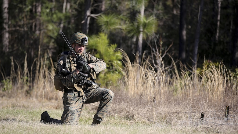 Cpl. Zachary Hannah, a combat engineer with 2nd Combat Engineer Battalion, communicates on a radio during the counter-improvised explosive device operations portion of the battalion's sapper squad competition at Marine Corps Base Camp Lejeune, North Carolina, March 22, 2016. The counter-IED portion of the competition put squads' observation skills to the test as they swept a lane of simulated IEDs.