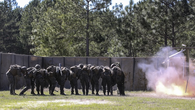 Marines with 2nd Combat Engineer Battalion breach a door during the assault breaching portion of the battalion's sapper squad competition at Marine Corps Base Camp Lejeune, North Carolina, March 22, 2016. The competition was organized to determine the most proficient squads in the battalion while simultaneously challenging squads in the execution of combat engineer-based tasks.