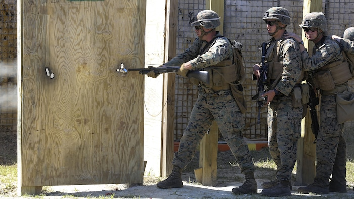 A Marine with 2nd Combat Engineer Battalion breaches a door with a Mossberg 500 shotgun during the assault breaching portion of the battalion's sapper squad competition at Marine Corps Base Camp Lejeune, North Carolina, March 22, 2016. The competition was organized to determine the most proficient squads in the battalion while simultaneously challenging squads in the execution of combat engineer-based tasks.