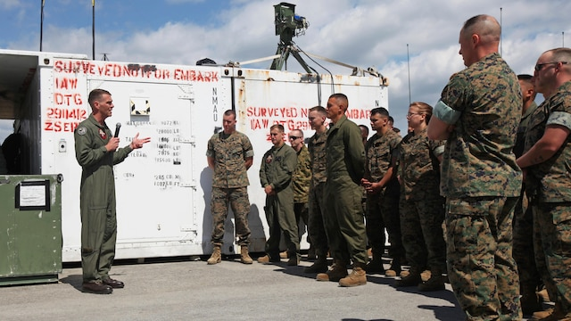 Lt. Col. Kris Faught speaks to Marines with Marine Unmanned Aerial Vehicle Squadron 2 before the first RQ-21A Blackjack flight into Class D airspace over Marine Corps Air Station Cherry Point, North Carolina, March 21, 2016. The RQ-21A Blackjack system is modular, flexible and multi-mission capable, providing roll-on, roll-off transitions between land and maritime environments. Faught is the commanding officer of VMU-2.