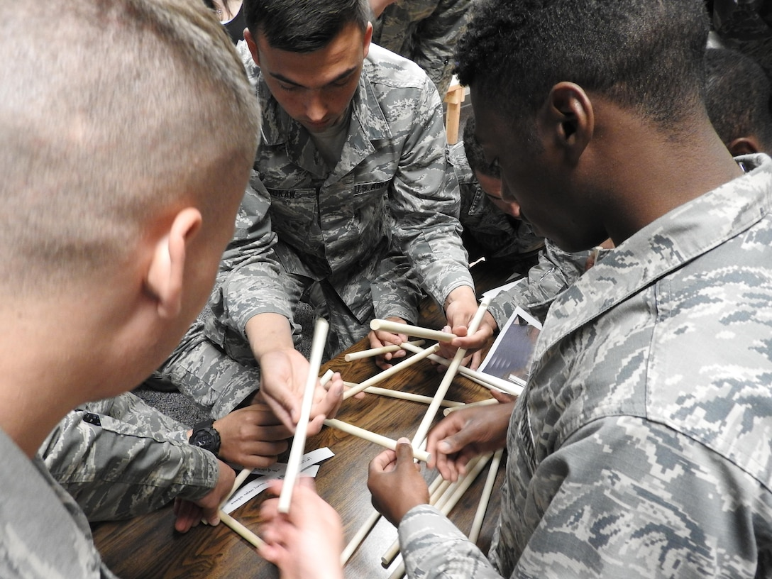 Airman 1st Class Jonathan Brokaw and other Mystery Escape Room participants work on a puzzle in the DaVinci's Secret room in Arnold Hall Community Center on Joint Base San Antonio-Lackland on March 1, 2016. Teamwork, communication and collaboration are keys to success in this team-building exercise.