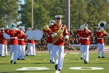 "Master Sgt. Keith Martinez, the drum major for the ""Commandant's Own"" Marine Corps Drum and Bugle Crops, leads his unit during the 2016 Battle Colors Ceremony, March 17 at Marine Corps Base Camp Lejeune. The Drum and Bugle Corps represents over 80 years of dedicated musicians who have served through relentless dedication to their craft and continuous practicing."