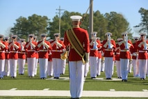 "The ""Commandant's Own"" Marine Corps Drum and Bugle Crops, executes precise close order drill during the 2016 Battle Colors Ceremony, Mar. 17 at Marine Corps Base Camp Lejeune. The Drum and Bugle Corps represents over 80 years of dedicated musicians who have served through relentless dedication to their craft and continuous practicing."