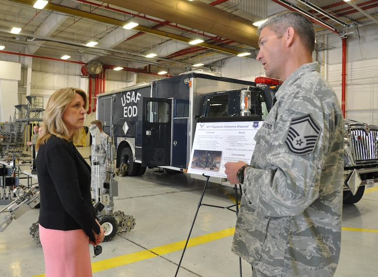 NAVAL AIR STATION FORT WORTH JOINT RESERVE BASE, Texas -- Secretary of the Air Force Deborah Lee James talks with Senior Master Sgt. Daniel Montrose, 301st Explosive Ordnance Disposal Flight chief, about the unit's 62,000-square-mile area of responsibility and partnership with federal and local authorities, March 23, 2016. During her visit, the secretary spoke with 10th Air Force and 301st Fighter Wing leadership, key spouses, Airmen and the sexual assault response coordinator. James also had the opportunity to visit with the Air National Guard's 136th Airlift Wing. (U.S. Air Force photo/Staff Sgt. Melissa Harvey)