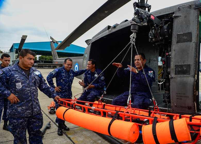 Members from the Salvadoran air demonstrate the use of and extractor and floating litter during a U.S. Air Force and Salvadoran air force subject matter expert exchange at Ilopango Air Base, El Salvador, March 8, 2016. 12th Air Force (Air Forces Southern) surgeon general's office, led a five member team of medics from around the U.S. Air Force on a week-long medical subject matter expert exchange in El Salvador. (U.S. Air Force photo by Tech. Sgt. Heather R. Redman/Released)