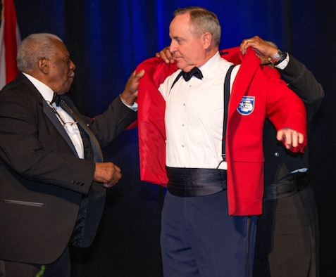Air Force Chief of Staff Gen. Mark A. Welsh III is inducted as an honorary Tuskegee Airman during the Tuskegee Airmen Foundation's 75th anniversary commemoration in Montgomery, Ala., March 22, 2016. (U.S. Air Force photo/Trey Ward)