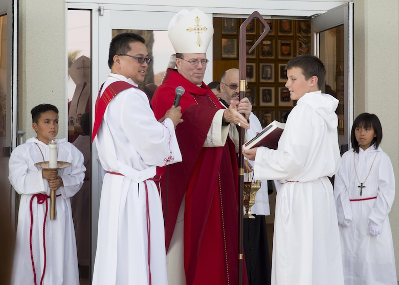 Bishop Neal J. Buckon, Military Archdiocese Vicar for the Western Region, begins Palm Sunday mass at the Combat Center's Catholic Chapel, March 20, 2016. (Official Marine Corps photo by Cpl. Connor Hancock/Released)