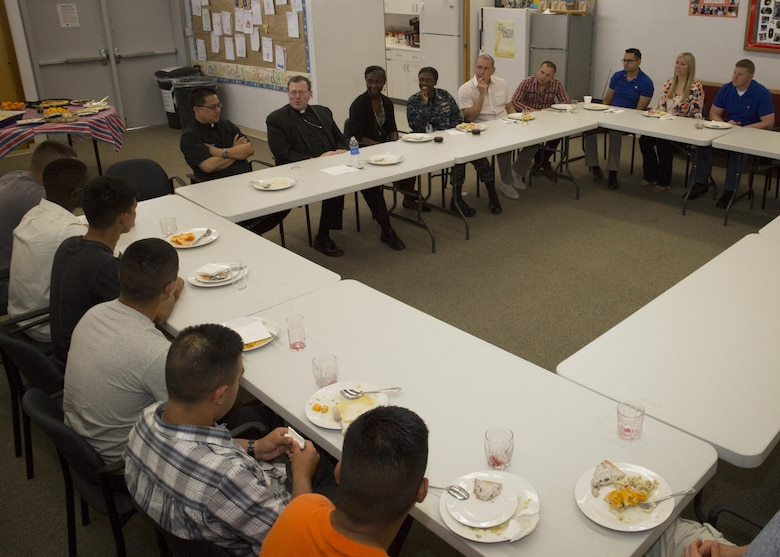 Bishop Neal J. Buckon, Military Archdiocese Vicar for the Western Region, speaks to Marines, sailors and church members during a pastoral visit at the Combat Center's Catholic Chapel, March 19, 2016. (Official Marine Corps photo by Cpl. Connor Hancock/Released)
