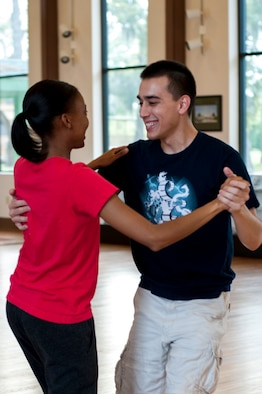 U.S. Air Force 2nd Lt. Simon Pena, 23d Force Support Squadron lodging officer, teaches Senior Airman Candice Bates, 23d Aerospace Medicine Squadron dental assistant, proper techniques during a ballroom dance class, March 24, 2016, at Moody Air Force Base, Ga. Pena uses his experience in nearly 20 different styles of dance to teach Moody Airmen and their families. (U.S. Air Force photo by Airman 1st Class Lauren M. Johnson/Released)