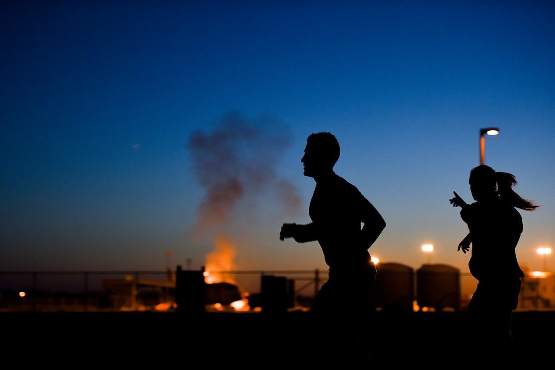 Rob Harris, KIDY Fox reporter, runs past the Louis F. Garland Department of Defense Fire Academy during a physical training session with the 17th Training Wing on Goodfellow Air Force Base, Texas, March 25, 2016. Harris participated in the exercise as part of a news series covering local fitness practices. (U.S. Air Force photo by Senior Airman Devin Boyer/Released)