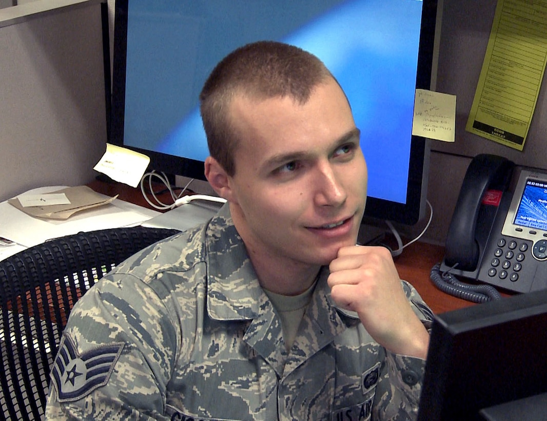 Staff Sgt. Mitchell Ciccarelli, Air Reserve Personnel Center casualty services technician, discusses a video filmed in the ARPC public affairs studio March 9, 2016, on Buckley Air Force Base, Colo. Ciccarelli was selected as the 2015 Headquarters Air Force Reserve Command Airman of the Year (U.S. Air Force photo/Quinn Jacobson)