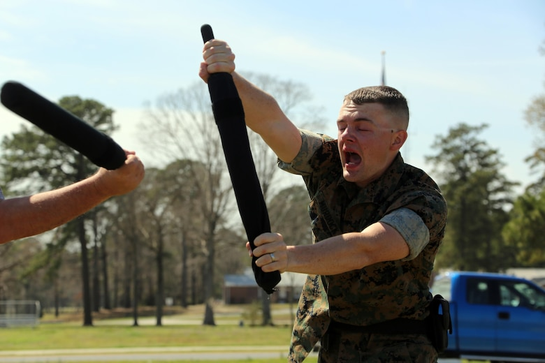 Lance Cpl. Brandon Murdock participates in an obstacle course during non-lethal weapons training at Marine Corps Air Station Cherry Point, N.C., March 17, 2016. Twelve Marines from various units participated in the training event with the Provost Marshal's Office. Marines were sprayed in the face with the potent substance and then maneuvered through an obstacle course simulating non-compliant threats. The training familiarized the participants with both the gear they will carry and the effects it will have on an individual being sprayed. Murdock is an avionics technician with Marine Aviation Logistics Squadron 14. (U.S. Marine Corps photo by Cpl. N.W. Huertas/Released)
