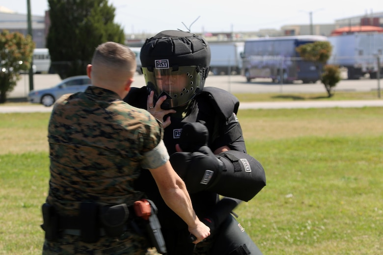 Lance Cpl. Brandon Murdock, left, conducts subduement techniques on Sgt. Patrick Hayes, right, during non-lethal weapons training at Marine Corps Air Station Cherry Point, N.C., March 17, 2016. Twelve Marines from various units participated in the training event with the Provost Marshal's Office. Marines were sprayed in the face with the potent substance and then maneuvered through an obstacle course simulating non-compliant threats. The training familiarized the participants with both the gear they will carry and the effects it will have on an individual being sprayed. Murdock is an avionics technician with Marine Aviation Logistics Squadron 14 and Hayes is a criminal investigator with Headquarters and Headquarters Squadron. (U.S. Marine Corps photo by Cpl. N.W. Huertas/Released)