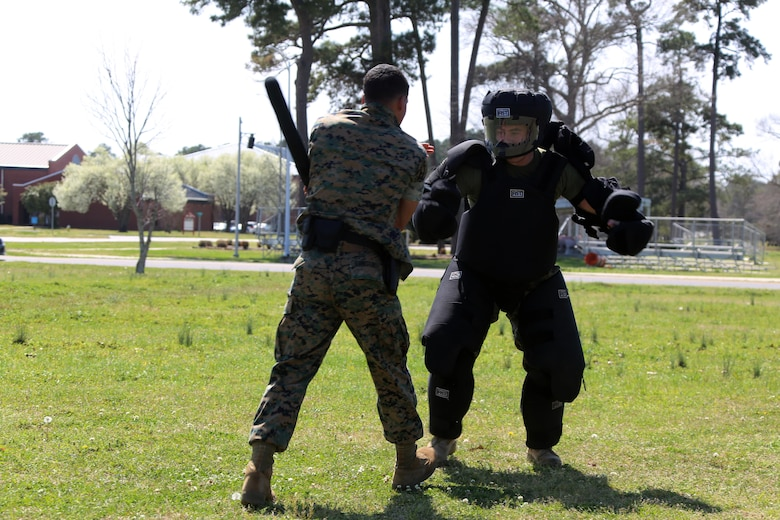 Lance Cpl. Xavier Tunstall, left, conducts subduement techniques on Sgt. Patrick Hayes, right, during non-lethal weapons training at Marine Corps Air Station Cherry Point, N.C., March 17, 2016. Twelve Marines from various units participated in the training event with the Provost Marshal's Office. Marines were sprayed in the face with the potent substance and then maneuvered through an obstacle course simulating non-compliant threats. The training familiarized the participants with both the gear they will carry and the effects it will have on an individual being sprayed. Tunstall is an administrative clerk and Hayes is a criminal investigator, both with Headquarters and Headquarters Squadron. (U.S. Marine Corps photo by Cpl. N.W. Huertas/Released)