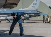 U.S. Air Force Airman Joseph Farmer, a crew chief with the 35th Maintenance Squadron, conducts a pre-flight check on an F-16 Fighting Falcon during exercise Beverly Sunrise 16-03 at Misawa Air Base, Japan, March 23, 2016. Misawa's crew chiefs are responsible for ensuring every F-16 meets its standards through inspection and maintenance. During the operational readiness exercise, Airmen worked at a faster pace, ensuring their ability to fight at a moment's notice. (U.S. Air Force photo by Airman 1st Class Jordyn Fetter)
