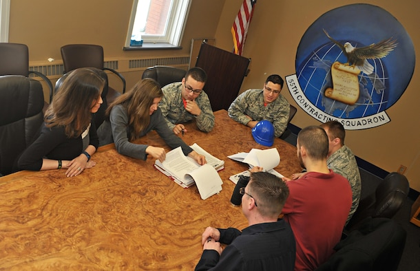 160325-F-HK400-001 – Members of the 55th Contracting Squadron discuss the negotiation objective for the base intrusion detection system March 25 in the 55th CONS conference room on Offutt Air Force Base, Neb. The squadron handles the contracting for the largest base, personnel wise, in Air Combat Command. (U.S. Air Force photo by Zach Hada)