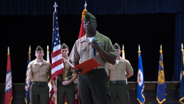 Col. Ossen J. D'Haiti, the commanding officer of MCCYWG, speaks to the audience during the activation of command ceremony of Marine Corps Cyberspace Warfare Group at Fort George G. Meade, Maryland, March 25, 2016. The mission of MCCYWG is to man, train and equip Marine cyberspace mission teams to perform both defensive and offensive cyber operations in support of United States Cyber Command and Marine Forces Cyberspace Command.