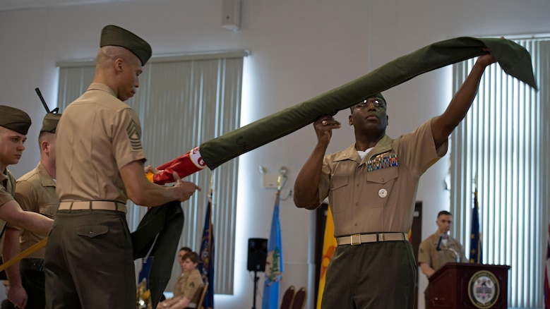 Col. Ossen J. D'Haiti, the commanding officer of MCCYWG, uncases the colors during the activation of command ceremony of Marine Corps Cyberspace Warfare Group at Fort George G. Meade, Maryland, March 25, 2016. The mission of MCCYWG is to man, train and equip Marine cyberspace mission teams to perform both defensive and offensive cyber operations in support of United States Cyber Command and Marine Forces Cyberspace Command.