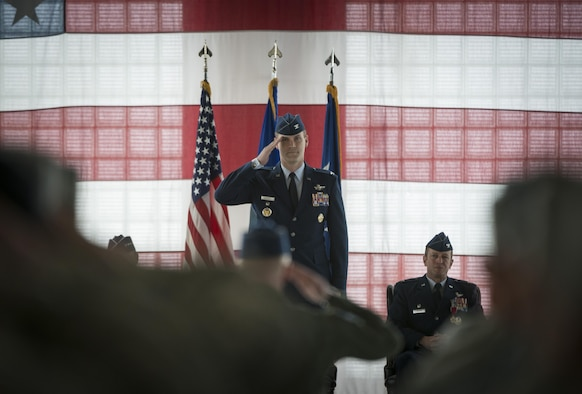 Col. Jefferson O'Donnell. 366th Fighter Wing commadner, renders his first salute as the wing commander, March 24, 2016, at Mountain Home Air Force Base, Idaho. O'Donnell acted as the vice wing commander for the previous nine months. (U.S. Air Force photo by Tech. Sgt. Samuel Morse/RELEASED)