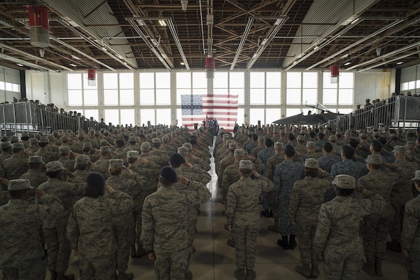 Airmen of the 366th Fighter Wing salute during the National Anthem, March 24, 2016, at Mountain Home Air Force Base, Idaho. Col. Jefferson O'Donnell took command of the wing after serving as the vice wing commander for the previous nine months. (U.S. Air Force photo by Tech. Sgt. Samuel Morse/RELEASED)