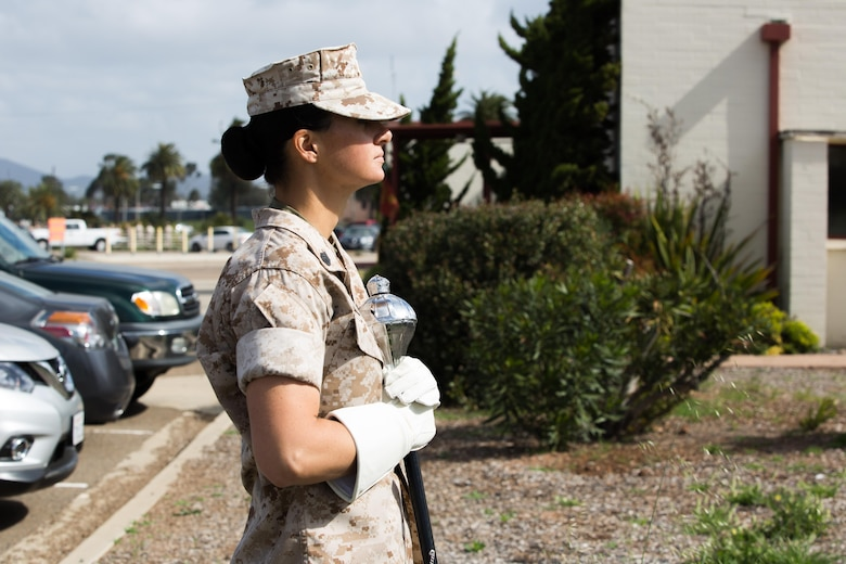 Staff Sgt. Monica Preston, assistant drum major and clarinet instrumentalist with the 3rd Marine Aircraft Wing Band and Massillon, Ohio native, observes a band practice aboard Marine Corps Air Station Miramar, Calif., March 22. Marines with the 3rd MAW Band practice daily to prepare for future events and ceremonies. (U.S. Marine Corps photo by Sgt. Lillian Stephens/Released)