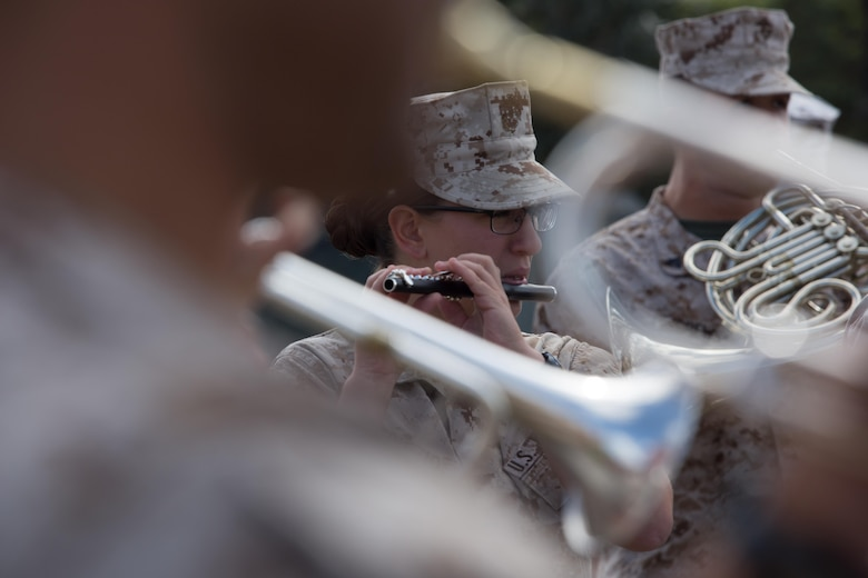 Lance Cpl. Samantha Spiezio, a flute instrumentalist with the 3rd MAW Band and Saratoga Springs, N.Y. native, practices with a piccolo aboard Marine Corps Air Station Miramar, Calif., March 22. Spiezio is the only flute instrumentalist in the 3rd MAW Band and often plays the piccolo during marching performances. (U.S. Marine Corps photo by Sgt. Lillian Stephens/Released)