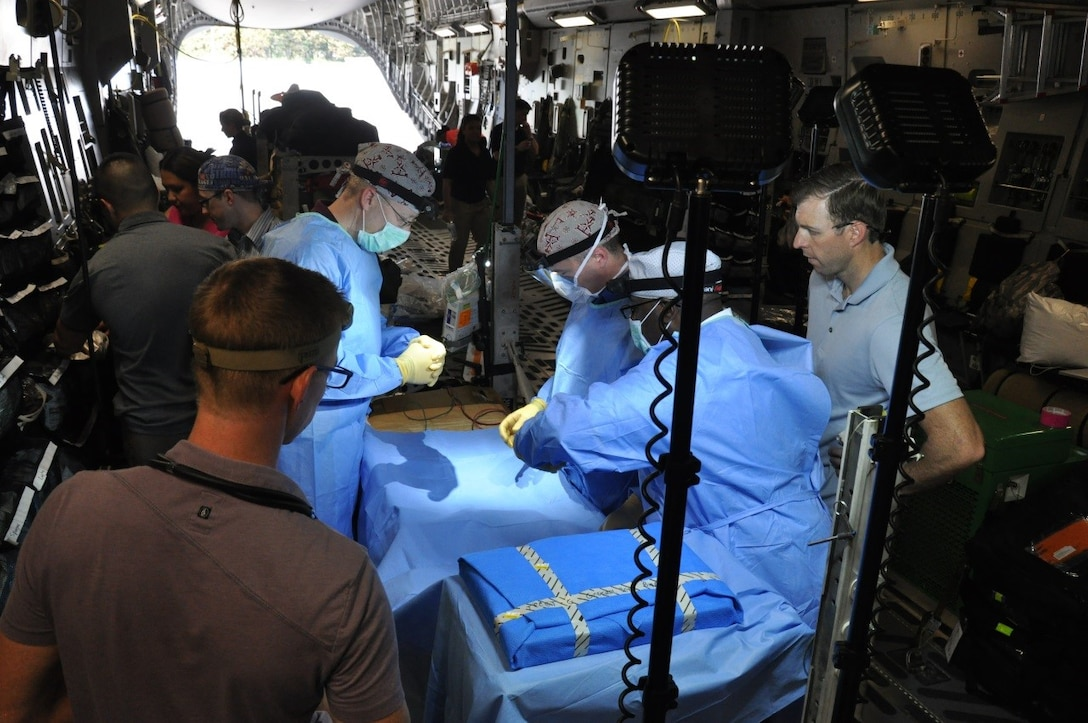 Medics from the 59th Medical Wing conduct a medical training exercise inside a C-17 Globemaster III on March 18, 2016, at the Havana International Airport, Cuba. A Tactical Critical Care Evacuation Team-Enhanced and a Critical Care Air Transport Team from the wing supported the first presidential visit to Cuba in nearly 90 years. The teams -- wearing civilian clothes for security -- were part of Defense Department, White House and State Department emergency response systems. (U.S. Air Force photo/Maj. Howard Blackwell)