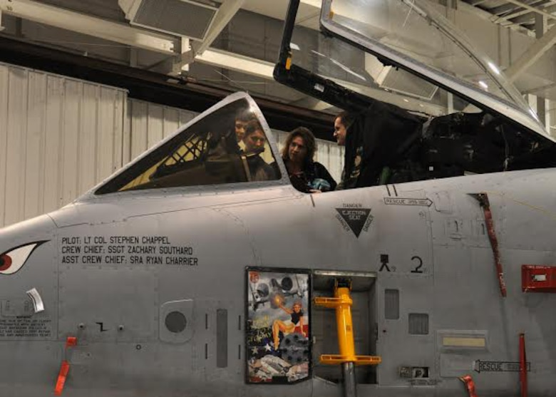 The cockpit of the A-10 Thunderbolt II is opened for students from the Wright Flight Program in Columbia, Mo., to view at Whiteman Air Force Base, Mo., March 24, 2015. The 442nd Fighter Wing is home to 27 A-10s. (U.S. Air Force photo by Airman 1st Class Missy Sterling/Released)
