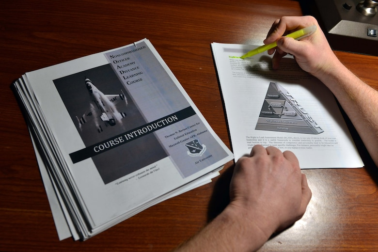 A U.S. Air Force Airman reviews Course 15 material, March 16, 2016, at Incirlik Air Base, Turkey. Course 15 is a distance-learning format for enlisted Airmen that is a portion of the NCO Academy experience. Regardless of rank, when enlisted Airmen reach their seven year time-in-service date, they will receive a notification from the Air Force Personnel Center and are required to enroll and complete Course 15 within a 12-month timeframe. (U.S. Air Force photo by Senior Airman John Nieves Camacho/Released)