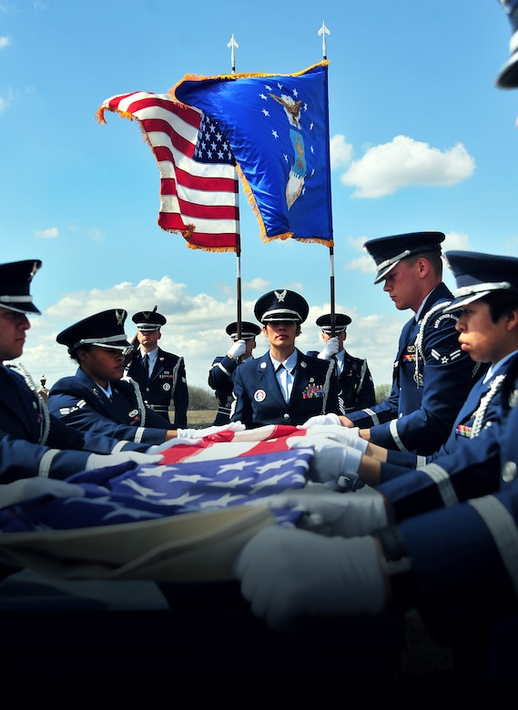 Members of Whiteman Honor Guard practice the procedures of a military funeral at Knob Noster cemetery in Knob Noster, Mo., March 15, 2016. Whiteman Honor Guard serves more than 100 counties spanning Missouri to Kansas covering more than 70,000 square miles across both states. Whiteman Honor Guard represents the respect each fallen service member deserves, and upholds traditions held dear to the armed forces. (U.S. Air Force photo illustartion by Airman 1st Class Jovan Banks)