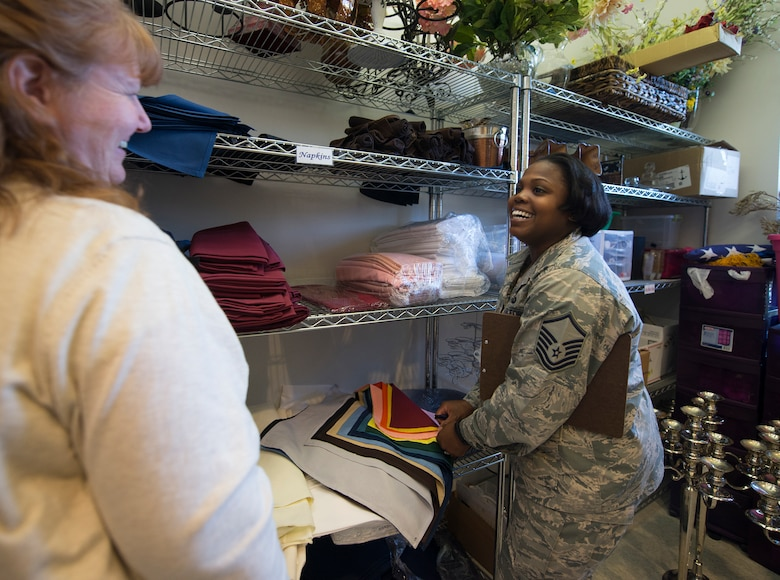 U.S. Air Force Master Sgt. Shonda Simes, the 509th Force Support Squadron NCO in charge of food and beverage, right, works with Karen O'Camb, the Mission's End club manager, to select the décor for the 2016 Women's History Month Celebration Breakfast at Whiteman Air Force Base, Mo., March 21, 2016. The theme for this year's celebration is Working to Form A More Perfect Union:  Honoring Women in Public Service and Government. (U.S. Air Force photo by Senior Airman Sandra Marrero)