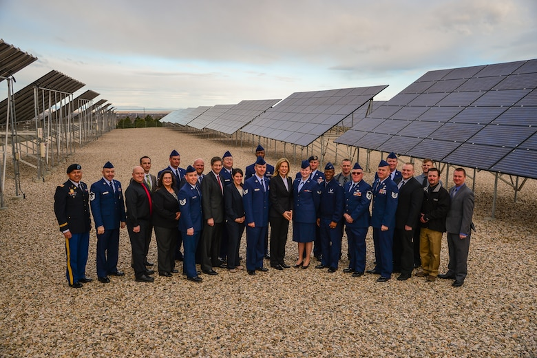 Dr. Elizabeth Sherwood-Randall, Deputy Secretary of Energy, center, poses with Solar Ready Vets participants March 25 at Hill Air Force Base's solar array field. The participants, comprising the first class from Hill AFB, graduated later in the day during a ceremony featuring Sherwood-Randall as the guest speaker. Hill was chosen to be part of the program based on the number of exiting military personnel from the installation, the strength of the surrounding solar market, and the capacity of nearby training institutions. (U.S. Air Force photo by R. Nial Bradshaw)