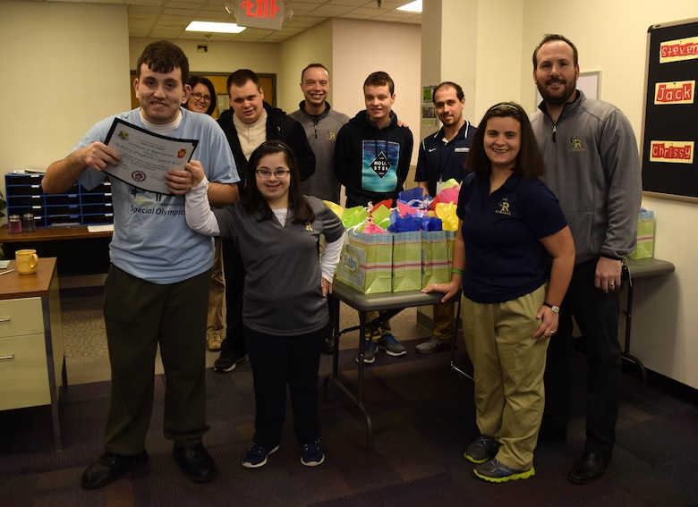 On March 15, 2016, students and faculty from the A.C.H.I.E.V.E. young adult special needs education program in Council Rock School District, Newtown, Pa. stand by baby shower gifts bound for the upcoming Moms-To-Be Celebration. The gift bags, brimming with stuffed animals and small hygiene items were a hit at the celebration in Valley Forge, Pa. on March 19. (U.S. Air National Guard photo by Master Sgt. Christopher Botzum)