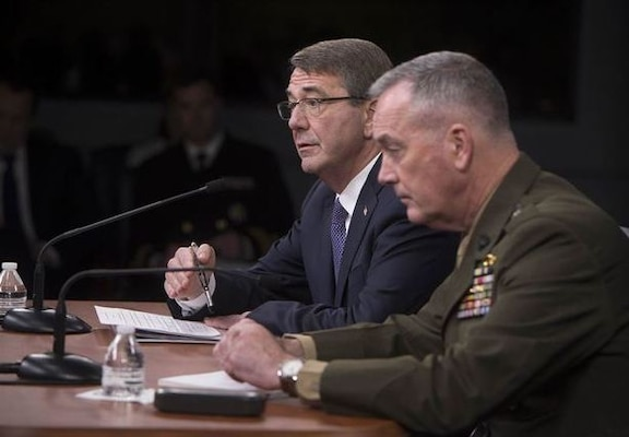 Defense Secretary Ash Carter and Marine Corps Gen. Joe Dunford, chairman of the Joint Chiefs of Staff, answer questions about efforts against the Islamic State of Iraq and the Levant during a news conference at the Pentagon, March 25, 2016. (DoD photo by Navy Petty Officer 1st Class Tim D. Godbee)