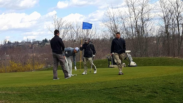 Participants compete for first place during the Riverview St. Patrick's Day Golf Tournament on March 18.