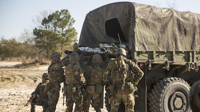 Dutch Marines with 32nd Raiding Company load the casualty onto a Medium Tactical Vehicle Replacement 7-ton during a casualty evacuation exercise at Marine Corps Base Camp Lejeune, North Carolina, March 22, 2016. The Dutch Marines spent the past three weeks utilizing Camp Lejeune's training facilities, as well as cross-trained with U.S. Marines to learn and share tactics, techniques and procedures.
