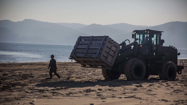 A U.S. Marine with Combat Logistics Battalion 31, 31st Marine Expeditionary Unit ground guides a Tractor, Rubber-tired Articulated, Multi-purpose vehicle to load equipment onto a Landing Craft Air Cushion assigned to Naval Beach Unit 7 during Exercise Ssang Yong 16, Dogu Beach, Pohang, South Korea, March 17, 2016. Ssang Yong 16 is a biennial combined amphibious exercise conducted by U.S. forces with the Republic of Korea Navy and Marine Corps, Australian Army and Royal New Zealand Army forces in order to strengthen interoperability and working relationships across a wide range of military operations. The Marines and sailors of the 31st MEU are currently deployed aboard the Bonhomme Richard Amphibious Ready Group as part of their spring deployment of the Asia-Pacific region.
